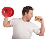 Gewichte gegen Sandwich Stockfotos