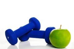 Gewichten en appel Royalty-vrije Stock Afbeeldingen