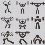 Gewichthebenikonen Lizenzfreie Stockfotos