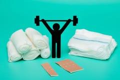 Gewichtheffenpictogram, het broodje van het pleisterverband en schaar stock foto