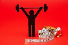 Gewichtheffenpictogram met pillen, meetlint stock afbeelding