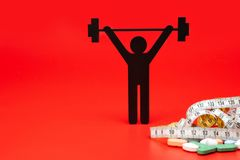 Gewichtheffenpictogram met pillen, meetlint stock foto's