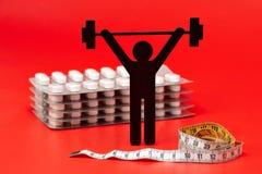 Gewichtheffenpictogram, pillen, meetlint royalty-vrije stock foto