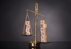Gewichtungsrisiko und -belohnungen Lizenzfreies Stockfoto