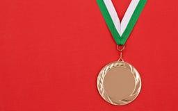 Gewinnende Medaille Lizenzfreie Stockfotos