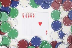 Gewinnende Pokerhand mit Rahmen des Kasinos bricht ab Stockfotos
