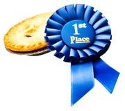 Gewinnendes Abzeichen mit einer Torte Lizenzfreie Stockfotografie
