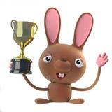 gewinnt nettes Karikatur 3d Ostern-Häschen die Goldcuptrophäe Stockfoto