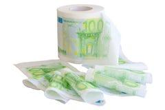 Gewirbeltes weg Toilettenpapier mit Bild mit 100 dem Eurobanknoten Lizenzfreie Stockfotografie