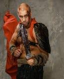 Gewonde gladiator met zwaard Royalty-vrije Stock Foto's
