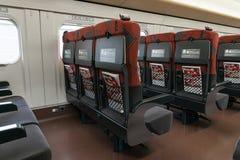 Gewone zetels van de trein E7/W7-van de Reekskogel (Hoge snelheid) royalty-vrije stock fotografie