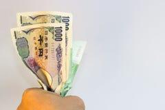 Gewonnene und japanische Yen des Koreaners Stockbild