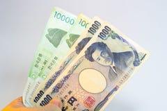 Gewonnene und japanische Yen des Koreaners Stockfotografie