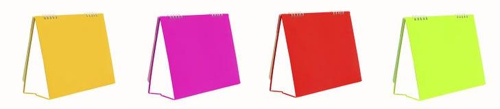 Gewundener Kalender über einem weißen Hintergrund Lizenzfreie Stockfotos