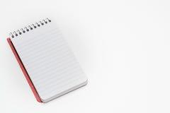 Gewundenes Notizbuch im Taschenformat lizenzfreie stockfotografie