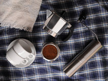 Geyser coffee, grinder and white cups on blue plaid texture. Geyser coffee, grinder and white cups on plaid blue tablecloth Royalty Free Stock Photos