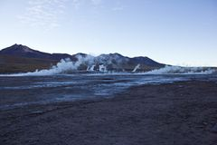 Geyser del Tatio in Chile before sunrise royalty free stock photography