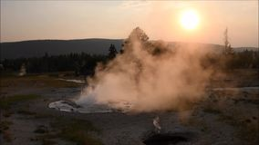 A geyser erupting steam stock footage