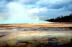 Geyser eruption with beautiful clouds. Geyser eruption in yellow stone national park Stock Photo
