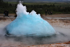 Geyser eruption in a sunny day. Royalty Free Stock Photo
