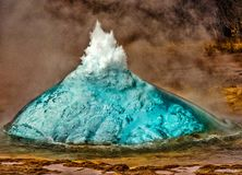 Hot geyser preparing to erupt. Geyser in Iceland begins eruption by first forming a bubble of hot water, before bursting into the air stock images