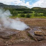 Geyser in Iceland, in the circle of gold stock image