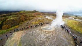 Geyser in Iceland erupting. Geyser Park in Iceland. Stokkur eruption with sunstar in a beautiful autumn day stock video