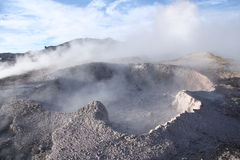 Geyser with mud and vapor above in Bolivia Stock Photography