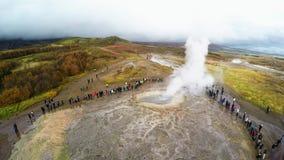 Geyser Park in Iceland. Stokkur eruption with sunstar in a beautiful autumn day. Aerial footage of erupting geyser stock footage