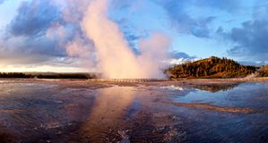 Geyser at sunset. stock images