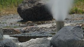 Geyser surround with rocks. Hot water is push through the tube surround with rocks, Geyser from Sun Kam Pang Hotspring, Chiang Mai, Thailand stock video footage