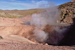Geysers expelling vapor in the early morning. Geysers expelling hot water vapor in the early morning Stock Images