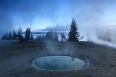 Geysers and lake in Yellowstone Royalty Free Stock Image