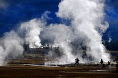 Geysers and Steam Rising in Yellowstone National Park stock photo