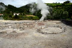 Geysers, Volcano Caldera Hot Springs Fumarole Bubbling Smoking in Furnas, Sao Miguel, Azores, Portugal. Geysers, Volcano Caldera Hot Springs Fumarole Bubbling stock photography