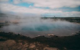 Geysir hot very blue water spring with steam iceland. Geysir hot very blue water spring with steam in iceland stock image