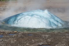 Geysir. The little gejsir and its eruption on Island Royalty Free Stock Photo