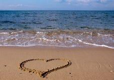 Gezeichnet in das Sandinnere auf dem Meer Lizenzfreies Stockbild