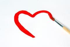 Gezeichnete Bürste des Herzens Form mit roter Farbe Lizenzfreie Stockfotos