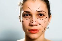 Gezeichnetes Gesicht für Schönheitschirurgie Lizenzfreie Stockfotos