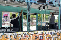 Gezi Park protests. Damaged public bus being used as barricade. Istanbul, Turkey - June 9, 2013: Unknown persons damaged the paint public tools. Gezi Park royalty free stock photos