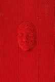 Gezicht aan de rode raad die van de speldkunst wordt gedrukt royalty-vrije stock foto