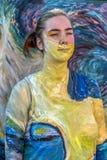 Gezicht en lichaam het schilderen van een vrouw Stock Foto