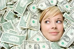 Gezicht in Geld stock foto's