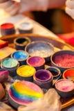 Gezicht het schilderen kleuren Stock Foto's