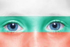gezicht met Bulgaarse vlag Stock Foto's