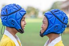 Gezicht twee van Mini Rugby-jongensspeler stock afbeeldingen