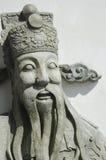 Gezicht van Chinees standbeeld bij Wat Pho-tempel Stock Foto