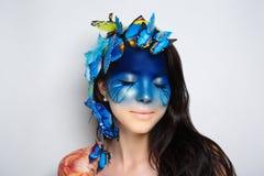 Gezicht van de vrouwen het blauwe kunst royalty-vrije stock fotografie