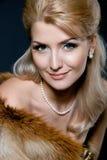 Gezicht van een mooie jonge blonde vrouw Stock Foto's